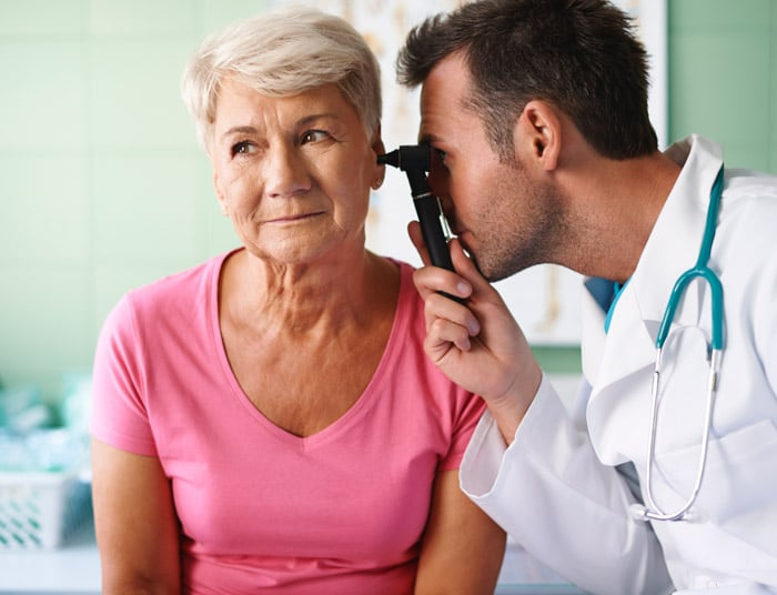 person receiving ear exam