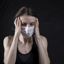 A woman with hearing loss wearing a mask.